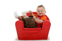 Young kid. With brown hair and brown eyes sitting in chair Royalty Free Stock Images