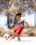 Young kid in action. Enjoying soccer, outdoors Stock Photos