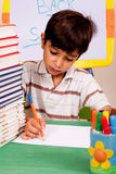 Young kid busy in drawing Royalty Free Stock Photo