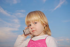 Young kid with cellphone Stock Image