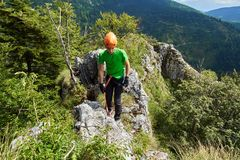 Boy climbing on via ferrata. Young kid climbing on via ferrata route Royalty Free Stock Images