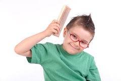 Young kid combing his hair Stock Images