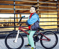 Young kid on cool bmx bicycle riding outside, lifestyle people c Stock Images