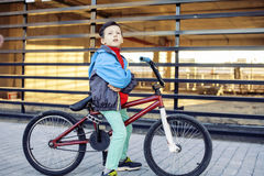 Young kid on cool bmx bicycle riding outside, lifestyle people concept Stock Photo