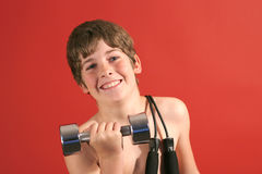 Young kid curling weights. Shot of a young kid curling weights Stock Photo