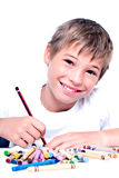 Young kid drawing. Royalty Free Stock Image