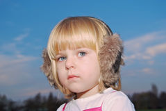 Young kid with earmuffs outside Stock Images