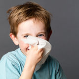 Young kid enjoying using tissue after cold or spring allergies Royalty Free Stock Photos