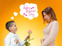 Young kid giving red rose to his mom Royalty Free Stock Images