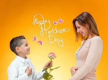 Young kid giving red rose to his mom Royalty Free Stock Photography