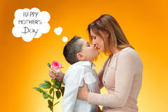 Young kid giving red rose to his mom Royalty Free Stock Photo