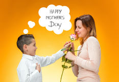 Young kid giving red rose to his mom Royalty Free Stock Image