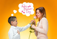 Young kid giving red rose to his mom Stock Photography