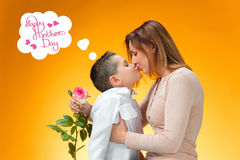 Young kid giving red rose to his mom Royalty Free Stock Photos