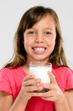 Young kid with glass of milk Stock Images
