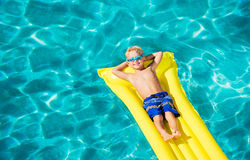 Young Kid Having Fun in Swimming Pool royalty free stock image