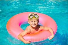 Young Kid Having Fun in Swimming Pool Stock Photos