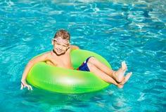 Young Kid Having Fun in the Swimming Pool Stock Photo