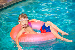 Young Kid Having Fun in the Swimming Pool Royalty Free Stock Photos