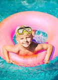 Young Kid Having Fun in the Swimming Pool Royalty Free Stock Images