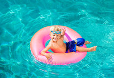 Young Kid Having Fun in the Swimming Pool Stock Photography