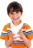 Young kid holding a glass of milk Stock Photos