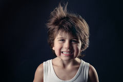 Young kid with humor expression and flying hair Stock Image