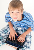 Young kid with laptop Stock Photo