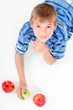 Young kid laying on the floor Stock Photography