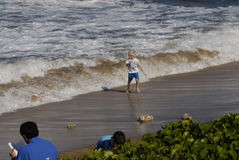 YOUNG KID AND OCEAN TIDES Stock Image