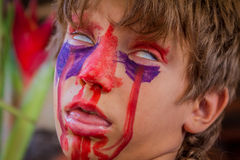 Young kid with painted face, child zombie face art Royalty Free Stock Photo