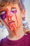 Young kid with painted face, child zombie face art Stock Photography