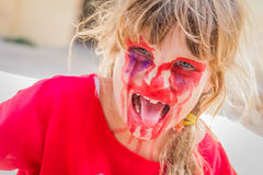 Young kid with painted face, child zombie face art Stock Photos