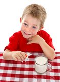 Young kid playing with toy cow near glass of milk Stock Image