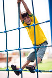 Young kid on playstructure Stock Photos