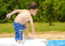 Young kid at pool Royalty Free Stock Photos