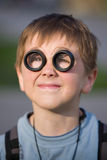 Young kid portrait with funny lenses on his eyes Stock Images