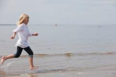 Young kid running Stock Photo