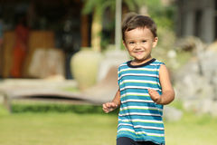 Young kid running and smiling. Young kid running and smile in the park Royalty Free Stock Images