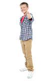 Young kid showing thumbs up gesture Stock Images