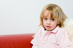 Young kid sitting down posing and smiling Stock Images