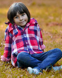 Young child sitting on grass Stock Photography