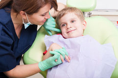 Young kid smiling in dental office Royalty Free Stock Photos