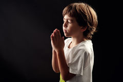 Young kid in a spiritual peaceful moment praying Stock Image