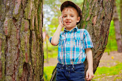 Young kid talking on mobile phone Stock Photo
