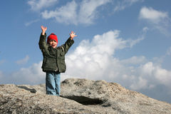 Young kid on top of the mountain Royalty Free Stock Images