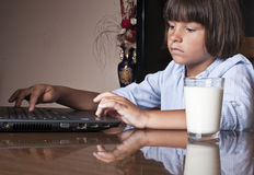 Young kid type on his lap top Royalty Free Stock Photo
