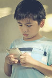 Young kid using mobile device Royalty Free Stock Photo