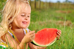 Young kid with watermelon outdoors Stock Photo