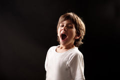 Young kid yawning Royalty Free Stock Photos